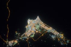 Kuwait City at Night  ISS032-E-023646 (15 Aug. 2012) --- This nighttime nadir view of Kuwait City, the coastal city which serves as Kuwait's political and economic capital, was photographed by one of the Expedition 32 crew members from the International Space Station. The metropolitan area has a population approaching two and a half million. A 200-mm lens was used to record the image.