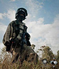 Russian SF operator - Spetsnaz soldier in a gorka mountain suit, K6-3 helmet, Blackhawk knee pads, and AKS-74 assault rifle.