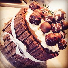 Delicious Genoise sponge, surrounded by crumbly flake, sandwiched with fresh cream and topped with Lindt chocolate, ferrerro Rocher and fresh chocolate covered strawberries. #chocolate #cake #cream
