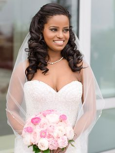Half-up, half-down curly wedding hairstyle for long hair