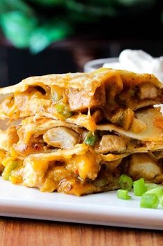 This amazing chicken quesadilla is made with cheese, chiles, chicken and a hint of garlic. Absolutely one of the best quesadillas you'll ever have!