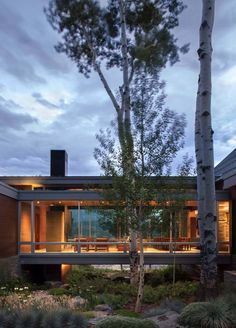 Sleek, contemporary dwelling in Colorado features a glass bridge