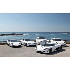 White koenigsegg Agera working on its tan with its mates! Can you name these white angles?