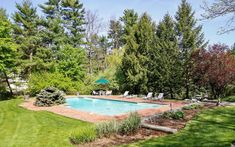 You will feel like you are on vacation every day with the Gunite, Shoreline heated pool and gorgeous 1 acre property with mature landscaping.