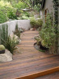 A retaining wall opens up space for a nice wood deck Magic Garden, Dream Garden, Garden Paths, Outdoor Rooms, Outdoor Gardens, Small Gardens, Outdoor Living, Landscape Architecture, Landscape Design