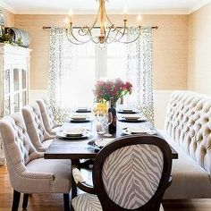 Beautiful Dining Room Adorned With Brass Chandelier Tufted Bench Chairs Grasscloth Wallpaper