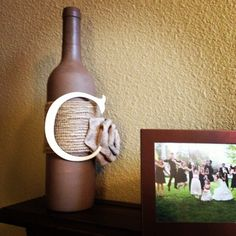 Easy DIY wine bottle craft. All I did was paint a bottle with acrylic paint, wrap the middle with burlap. Bought the pre-made burlap bow and letter C at Michael's, and hot-glued them on! Done :) the whole thing was under $10.