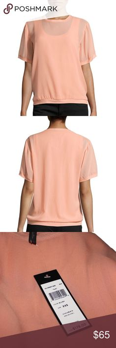 "BCBGMAXAZARIA Blush Aja Silk Overlay Top Pair this elegant T-shirt overlay tank with tailored pants and open-toe pumps for a supremely fabulous look.    Round neck. Short sleeves.  Tank lining.  100% Silk.    Measures approximately 25"" from shoulder to hem. BCBGMaxAzria Tops"