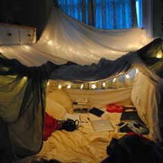 How to build an awesome blanket fort! I loved camping out like this. I think my sister and I spent an entire summer in one of these forts when I was eight.