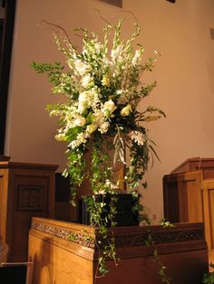 Lush natural altar arrangement with white delphinium, snapdragons, roses, and lisianthus (flowers by Lee Forrest Design)