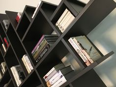 Diagonal custom made bookshelf.