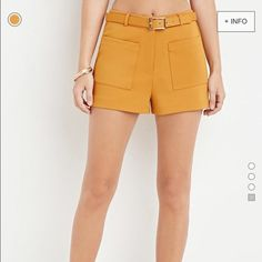 Forever 21 Belted Yellow Mustard Shorts Retro high-waisted mustard shorts. Cute front pockets and belt make these bottoms stylish and functional! Can be dressed UP with oxford shirt and tights for the modern, working woman // or dressed down with flowy blouse, and chunky heels, etc. Size S (fits like a 4-6) made by Forever 21.  Never worn, no tags. Forever 21 Shorts