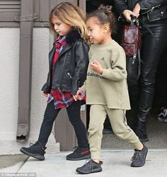 Inseparable: Penelope and North held hands as they left lunch earlier in the day with Kim Kardashian, Kanye West and Kourtney Kardashian