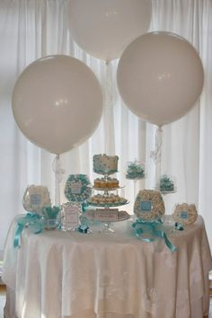 This wedding candy buffet offers celebrating with balloons.  See more wedding candy favors and party ideas at www.one-stop-party-ideas.com