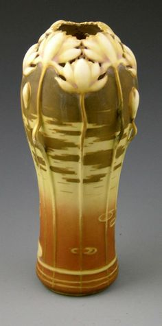 Art Nouveau Turn Teplitz Amphora Pottery Vase, circa 1910, with relief water lily decoration
