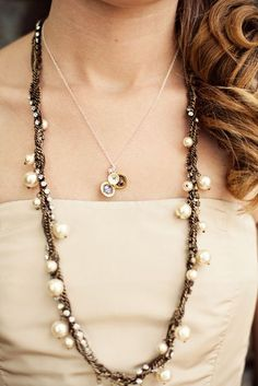 Chains circled with pearls & rhinestones.