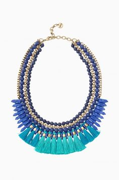 Our Tresse Statement Necklace is made of blue colored beads, gold chain and turquoise tassels. Shop blue tassel statement necklaces at Stella & Dot.