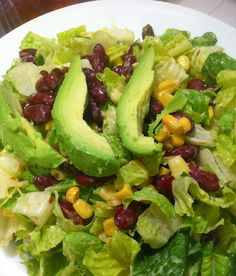Copycat Earls recipe: Santa Fe Salad! Crisp romaine lettuce topped with black beans, sweet corn, dates, and avocado, with a peanut lime dressing.