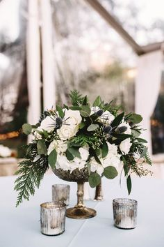 Elegant ivory, green, and dusty blue floral centerpiece   Stephanie Rogers Photography
