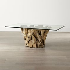 Shop Driftwood Coffee Table.    Collected along the shores of Indonesia, unfinished driftwood forms the base of this eclectic, live-edge coffee table, topped with retangular glass to provide a clear view of its natural, sculptural beauty.