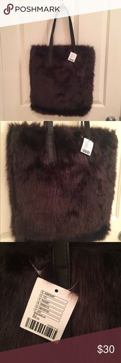 NWT! Urban Outfitters Faux Fur Tote Condition: NWT! Color: Brown  Faux fur tote bag that will take you anywhere + everywhere with majorly unforgettable style.  With a roomy, lined interior and doubled carrying handles that are perfect for toting around all your essentials + more, packaged in an irresistibly fun faux fur.  Color:  Brown Material:  Acrylic, polyester, modacrylic, cotton, polyester Wash: Spot clean Urban Outfitters Bags Totes