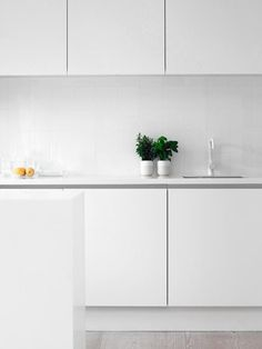 Simple all-white kitchen. Nothing wrong here.
