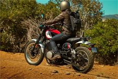 CHECK OU THE PACK HE'S WEARING WHILE RIDING  the 2017 Yamaha SCR950 Sport Heritage Motorcycle