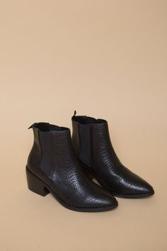 From Sol Sana the Edgar boot offers a fresh take on the classic Chelsea boot. Geometric elastic insets relax the ankle on these pebbled leather Sol Sana booties. Grosgrain pull tab at the top line. St