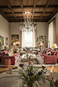 Living room with pink velvet sofa's and wooden ceiling
