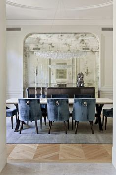sophisticated dining ... love the smoked mirrors and what an incredible chandelier