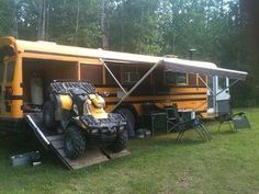 Skoolie conversion complete with ATV garage