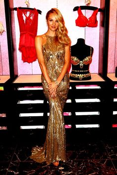 CANDICE SWANEPOEL WEARS ZUHAIR MURAD FOR THE REVEALING OF THE 2013 VICTORIA'S SECRET 'ROYAL FANTASY BRA'  Supermodel Candice Swanepoel looked beautiful wearing a gown Zuhair Murad. The gold beaded gown featured a high neckline and open back, and is from the Resort 2014 Ready-to-Wear Collection.