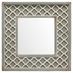 """Highlighted by a quatrefoil-adorned frame, this wood wall mirror brings a pop of pattern to your powder room or entryway decor.    Product: Wall mirrorConstruction Material: Wood and mirrored glassColor: Taupe frameDimensions: 29"""" H x 29"""" W x 1.5"""" D"""