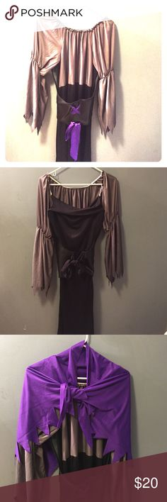 "Midnight Mistress Costume One size, very stretchy. Very versatile, could be used for a witch, vampire, or anything else you come up with. Has purple removable shawl and purple belt lace could be switched out for a different color. Last pic is the bottom approximately 58"" total length Other"