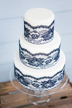 classic iced wedding cake with blue lace detail
