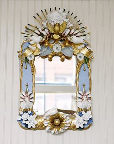 All of the objects in the mirrors are found at thrift stores, then assembled, plastered, and painted. The small Blue Bird mirror was the final addition to the space. It is a small sweet mirror covered in flowers and birds, more of a little jewel for a side corner of the restaurant.