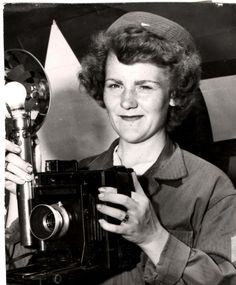 U.S. Marine Corps Women's Reserve (MCWR) photographer Jewel Rose Miller holds her 4x5 Anniversary Speed Graphic camera.