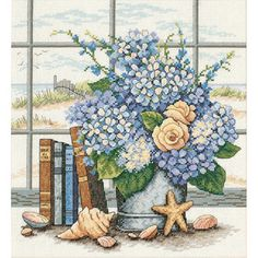 Get lost in your embroidery hobby with this Dimensions hydrangeas and shells cross-stitch kit. Barbara Mock's design shows a sand dune vista seen through a window, with a flower-filled vase, shells an