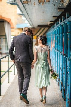 Bride & Groom Urban City Portrait - Image by Andrew Keher - Budget Wedding With Bride In Green Dress And Mimosa By Rachel Simpson Shoes At The Victoria Baths In Manchester With Reception At Greens By Simon Rimmer Images From Andrew Keher Photography