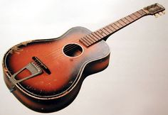 John Lennon's first guitar, The Gallotone Champion, now living at the Boston Museum of Fine Art