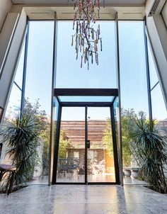 Double Height Inclined Structurally Glazed Façade with steel doors Glass Extension, Rear Extension, Extension Ideas, Steel Windows, Steel Doors, Glass House, Glass Door, Large Tile Bathroom, London Townhouse