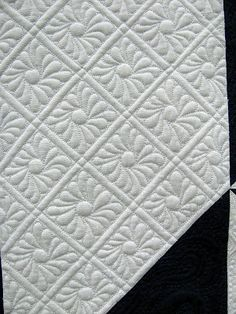 Daisy quilting. Feathered Star quilt by Amy Hunter. 2012 Oklahoma City Winter Quilt Show. Photo by Jan Hutchison.