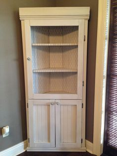Pantry. No chicken wire, solid door.