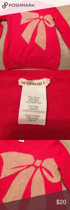 Crewcuts red bow wool sweater This is a very cute red wool sweater. Perfect for the holiday.  Excellent condition. Size  14. But runs small. I would say a 10. crewcuts Shirts & Tops Sweaters