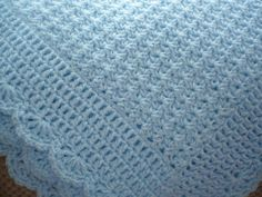 Baby Blue Baby Blanket with a Decorative Border by Aalexi on Etsy.