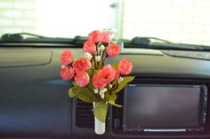 Flower vase for car:  http://www.ebay.co.uk/itm/Car-Van-Truck-Flower-Decor-Interior-Accessories-Decals-Novelty-Gift-Air-Con-Vent-/281061972826
