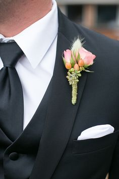 #Boutonniere | Jen + Ashley Photography | See the wedding on http://www.StyleMePretty.com/virginia-weddings/2014/01/14/elegant-backyard-wedding-in-newport-news/