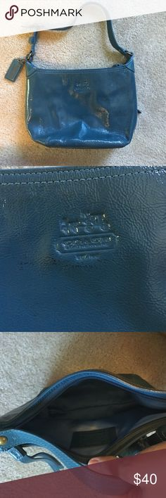 Small blue coach purse Blue coach purse with a couple markings shown above in the second picture. Used once Coach Bags