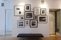 The entry way had been simply two white walls. 'We didn't want it to feel like a dead area when you walked in, so we put in a black and white photo wall,' Mr. Maharam said. Bookshelves are on the other wall.