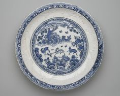 Platter (Tabaq) with Chinese Landscape, first half 17th century. Ceramic; fritware, molded and painted in cobalt blue under a transparent glaze, Gr. diam.: 19 in. (48.3 cm). Brooklyn Museum, Carll H. de Silver Fund, 73.166. Creative Commons-BY (Photo: Brooklyn Museum, 73.166_top_PS2.jpg)